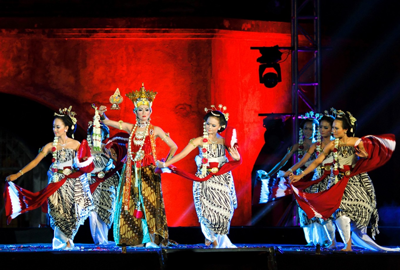 Dancers perform the 'Bidadari Genit' (flirty angels) dance choreographed by Paundra Karna.
