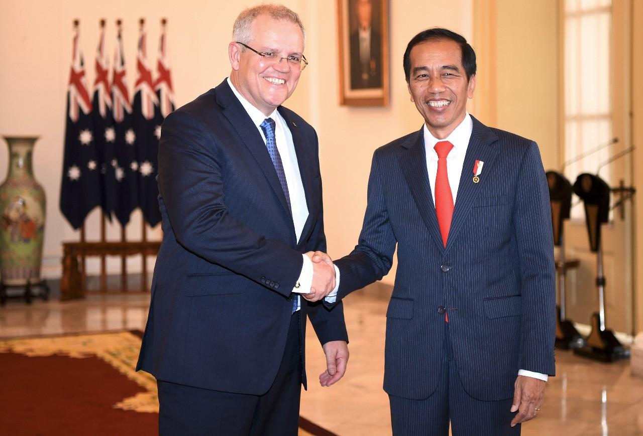 """President Joko """"Jokowi"""" Widodo (right) shakes hands with Australian Prime Minister Scott Morrison in Jakarta on Friday. Image: AFP/Sonny Tumbelaka"""