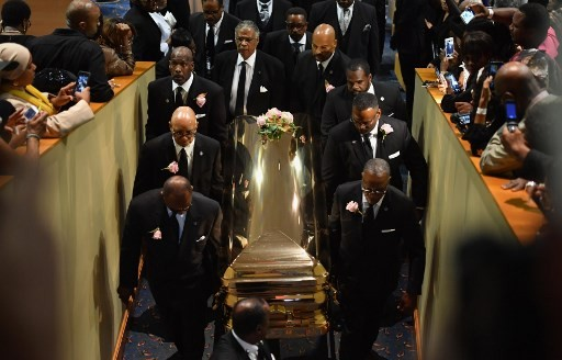 Pallbearers carry Aretha Franklin's casket after the funeral ceremony at Greater Grace Temple on August 31, 2018 in Detroit, Michigan.