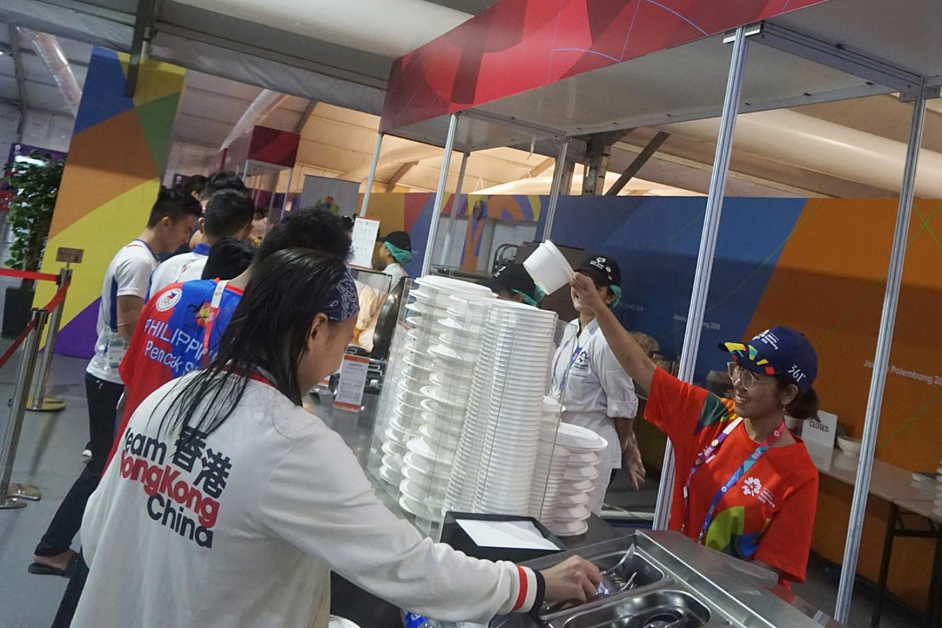 An officer takes orders from athletes at Jakarta athlete's village in Kemayoran. JP/Gemma Holliani Cahya