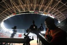 A photojournalist sets up his camera in Gelora Bung Karno (GBK) main stadium in Jakarta. JP/Seto Wardhana