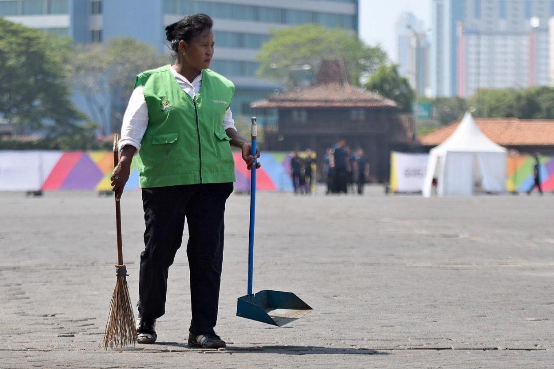 A cleaner does her routine at JIEXpo Kemayoran in Jakarta. JP/Wendra Ajistyatama