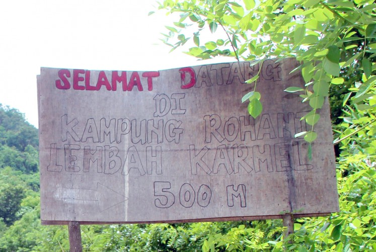 Seeking Eden: A sign near the camp welcomes those searching for serenity and the divine.