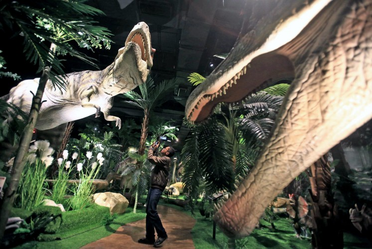 Prehistoric: A visitor takes a picture inside the Jurassic Research Center. Prehistoric: A visitor takes a picture inside the Jurassic Research Center.