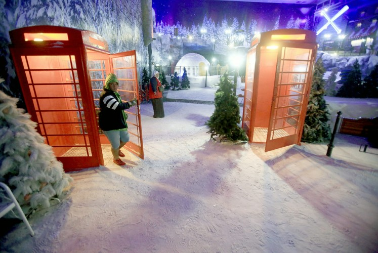 Mock winter: A visitor experiences the freezing cold in Snow World at Resorts World Genting, Malaysia.