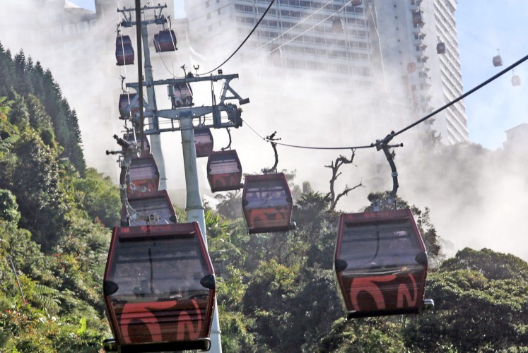 Floating: SkyWay cable cars glide through the clouds as they travel from Sky Avenue Station at Resorts World Genting, Malaysia.