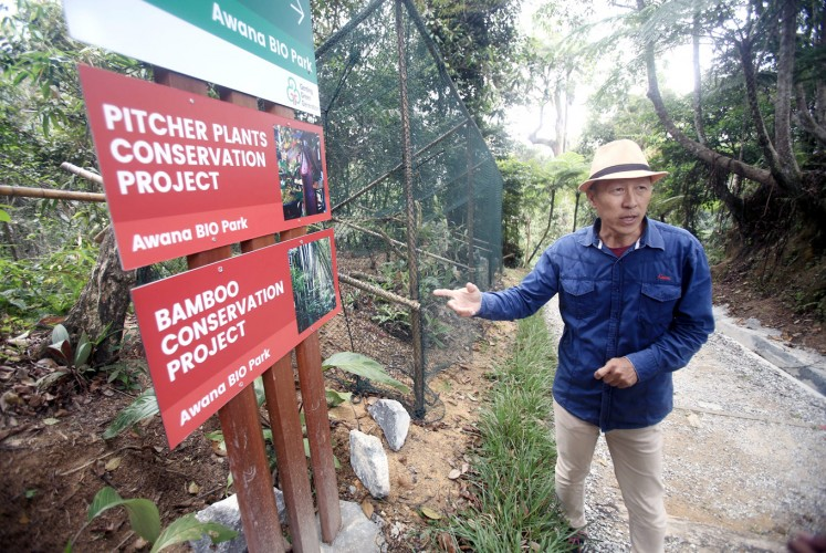 "Conservationist: Eddy Chan points to a sign board inside the Awana Bio Park at Resorts World Genting, Malaysia. The Bio Park offers excursions into the jungle dubbed the ""Fashion Forest""."