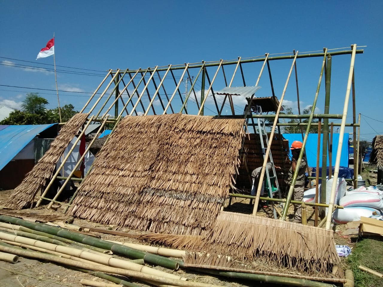 Quake survivors use salvaged materials to build better shelters, rebuild lives