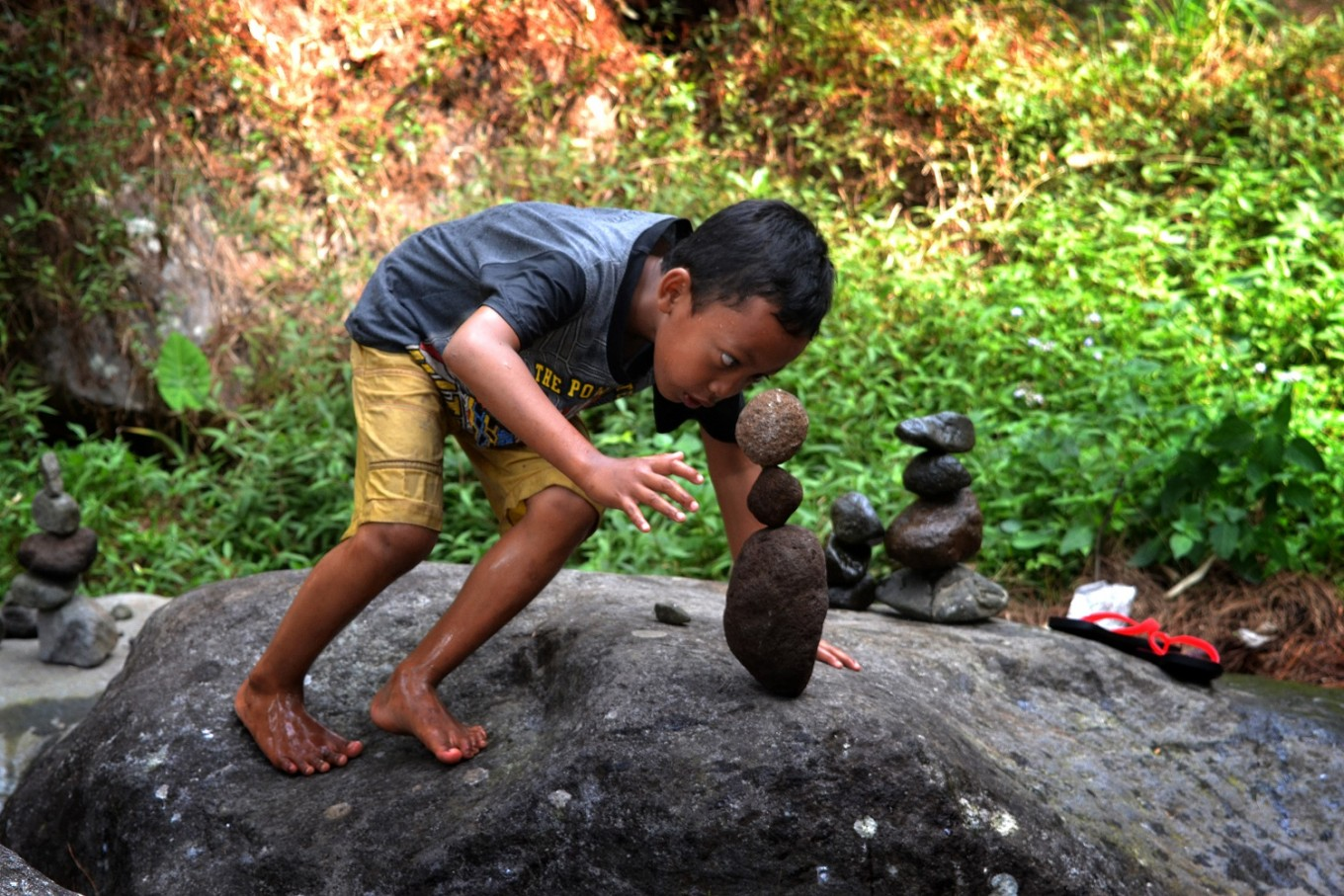 Rock balancing requires concentration and patience.