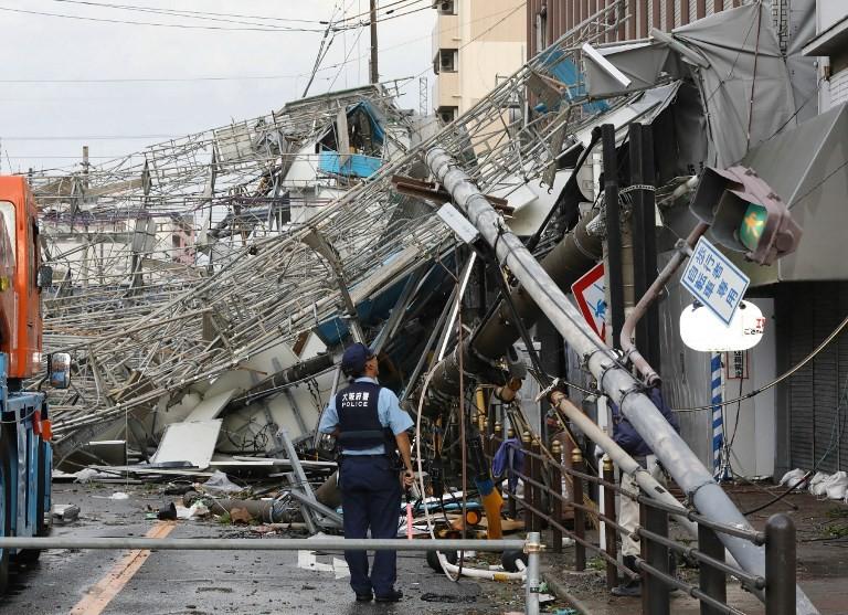 Powerful typhoon kills 9, shutters airport in Japan