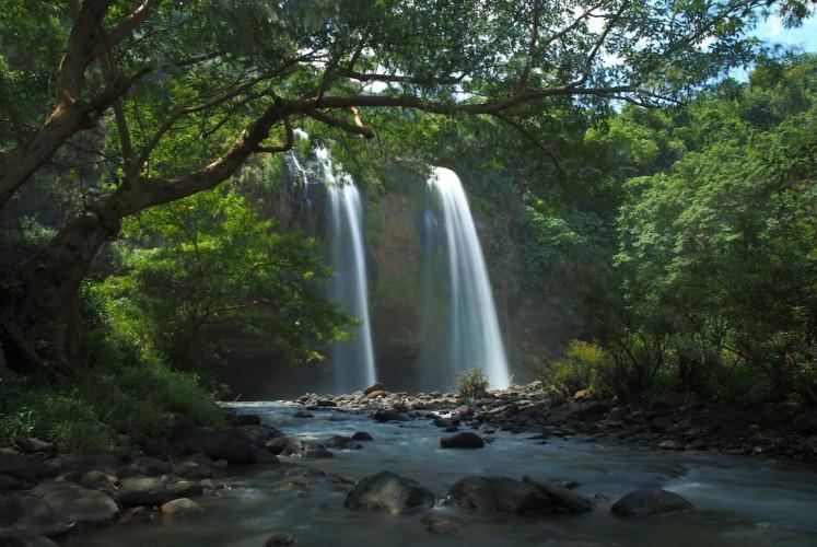 The Curug Sodong twin waterfalls at Ciletuh Geopark, Sukabumi.