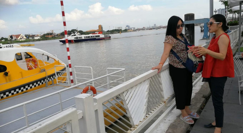 Wading through Saigon River on water bus