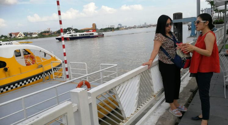 Wading through Saigon River on water bus