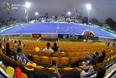 Supporters watch the Indonesia women's hockey team play against South Korea during the Asian Games at the GBK Hockey Field on Tuesday, Aug. 21. Inasgoc via Antara/ Dhoni Setiawan