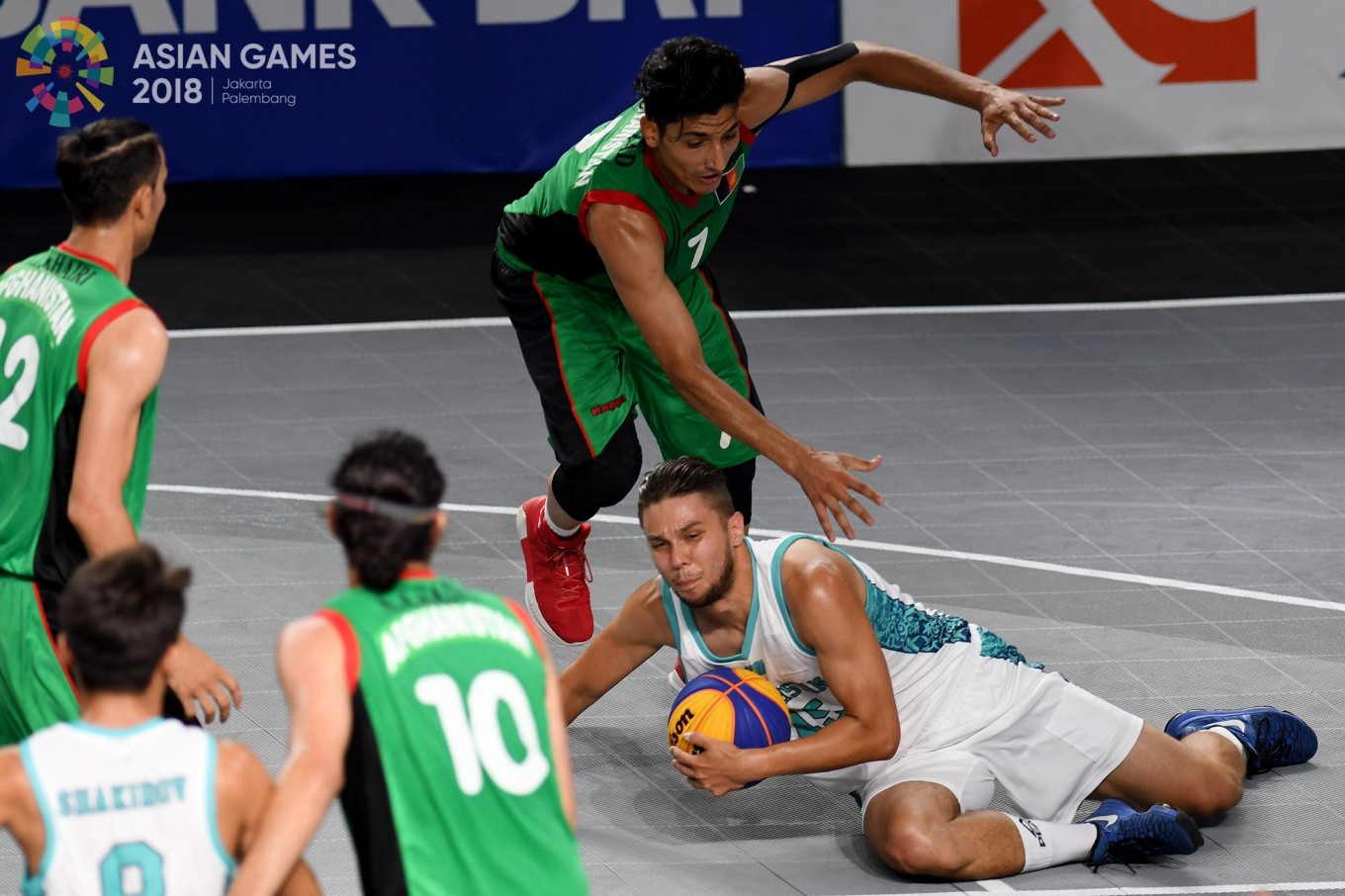 Afghanistan basketball player Mir Abdul Wahab Mirzad (right) tries to keep the ball away from Kazakhstan's Vassily Belozor during the men's 3x3 competition at the Basketball Hall of the GBK in Senayan, Central Jakarta, on Wednesday, August. 22. Inasgoc via Antara/ Wendra Ajistyatama
