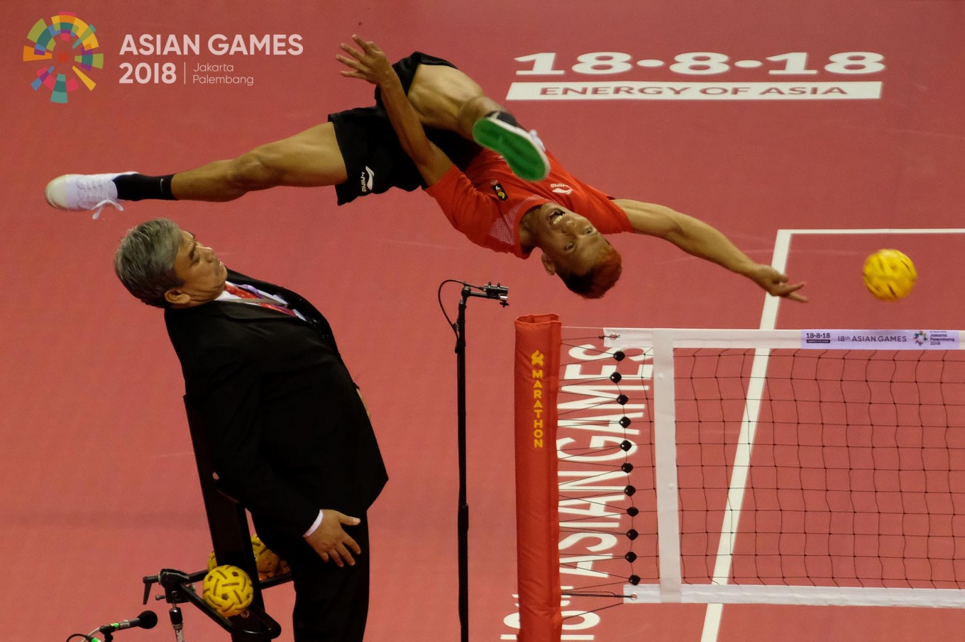 Indonesia's Herson Muhamad Saipul  jump for the ball in the sepaktakraw men's team regu match against Iran in Jakabaring Sport City, Palembang, August.19. JP/Jerry Adiguna