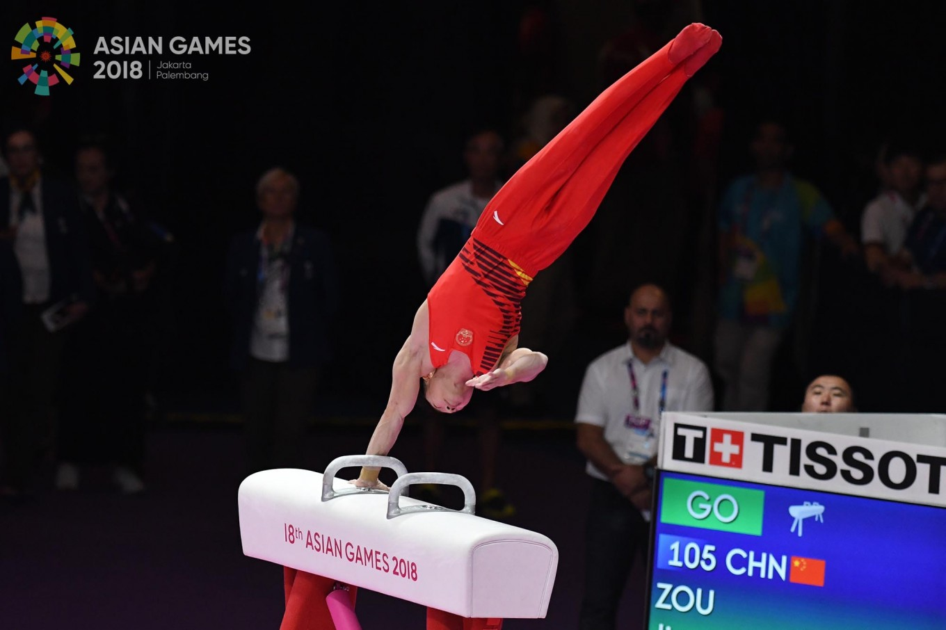 China's Jingyuan Zou competes on the pommel horse competition in the final at the artistic gymnastics event during the 2018 Asian Games in Jakarta on August.23. Inasgoc via Antara/ Wendra Ajistyatama