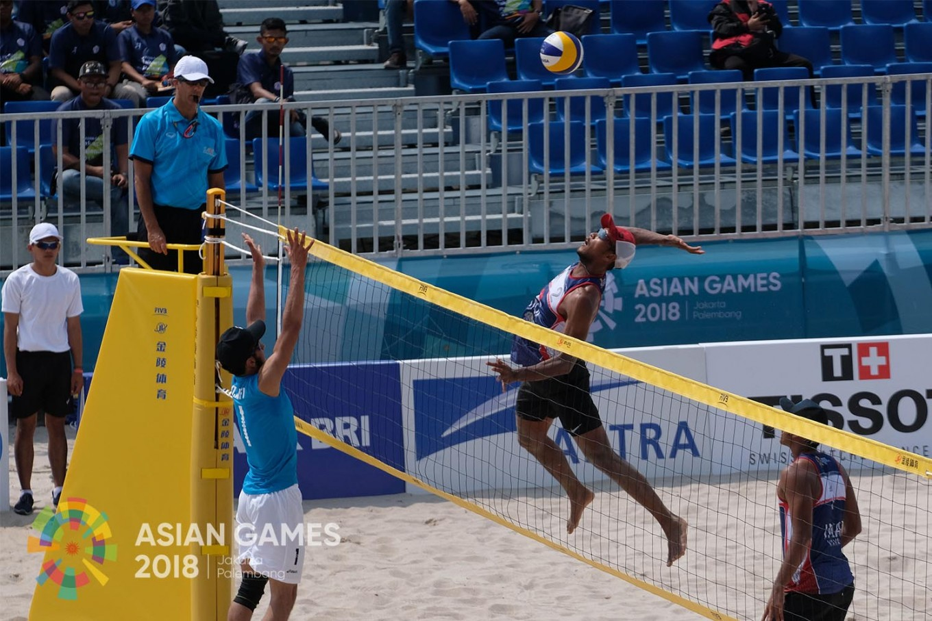 Indonesia's Ade Candra Rachmawan and Mohammad Ashfiya compete against Afghanistan's Ozair Mohammad Asifi - Mohib Jan Ahmadi in their men's beach volleyball semi-final during the 2018 Asian Games in Jakabaring Sport City, Palembang, August.19. JP/Jerry Adiguna