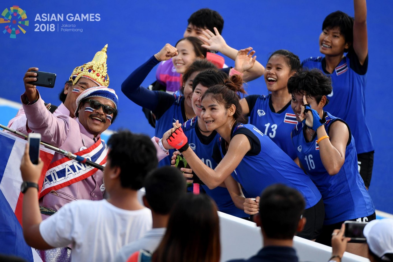 Thailand women's hockey players take a photo with their supporters after a game against Indonesia at the Asian Games at the GBK Hockey Field in Senayan, Central Jakarta, on Saturday, August. 25. Thailand won 2-0. Inasgoc via Antara/ Dhoni Setiawan