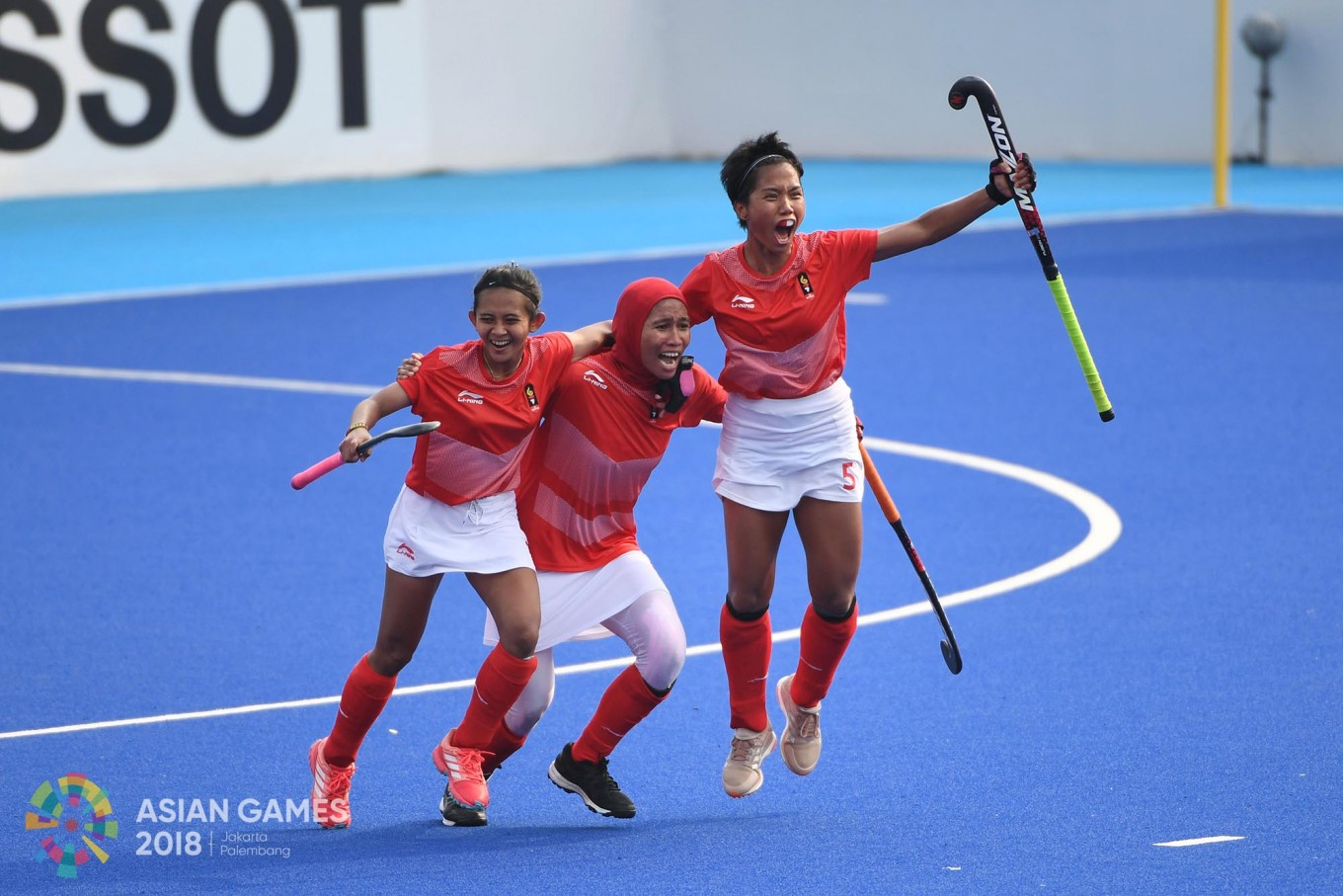Indonesia players celebrate after a goal during the women's hockey match between Indonesia and Kazakhstan at the 2018 Asian Games in Jakarta on August.23. Inasgoc via Antara/Dhoni Setiawan