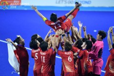 Japan's players celebrate their victory over Malaysia during the men's field hockey final match at the 2018 Asian Games in Jakarta on Sept.1. Inasgoc via Antara/Dhoni Setiawan