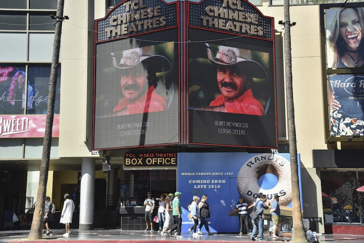 A picture of Burt Reynolds is seen on the TLC Chinese Theatre on the Hollywood walk of fame in Hollywood, California on September 6, 2018