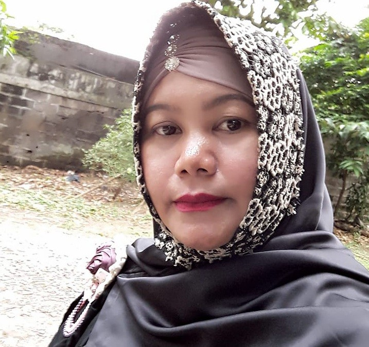 Forty-year-old Nur Komariah, known to her clients as Ibu Ria, has been a pawang hujanfor over two decades.
