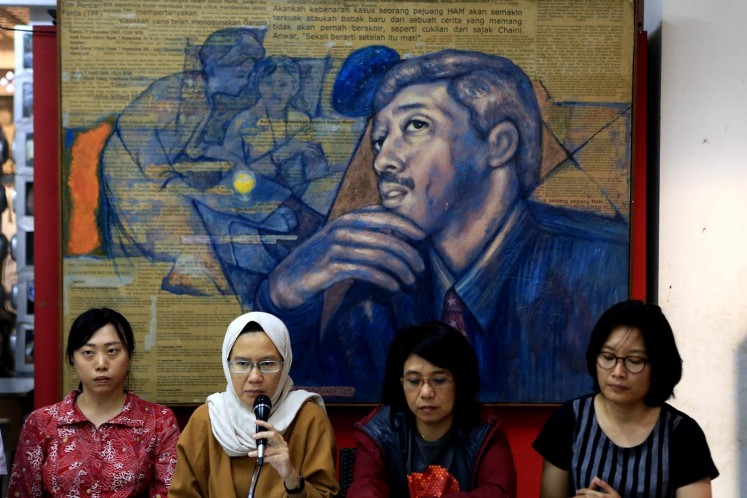 Yunita from LBH Jakarta, Kontras Coordinator Yanti Andriani, Munir's widow Suciwati and Puri Kencana from Amnesty International speak during a press conference in Jakarta on Sept. 7. Human rights activists have urged the government to solve the murder of activist Munir Said Thalib 14 years ago.