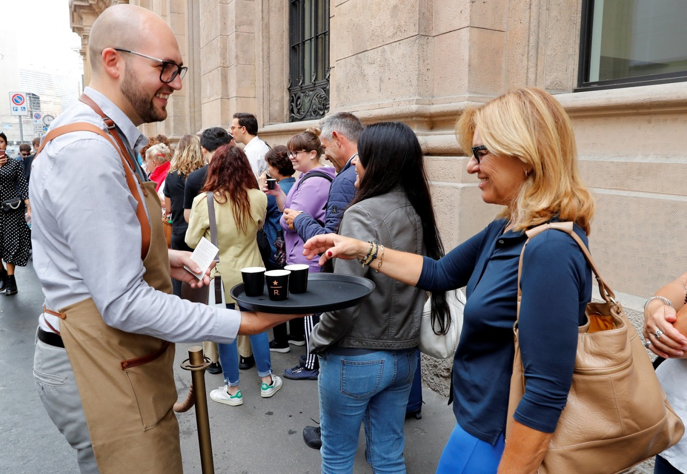 Starbucks pulls in crowds at first Italian cafe