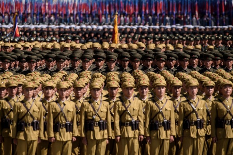 Korean People's Army (KPA) soldiers take part in a mass rally on Kim Il Sung square in Pyongyang on September 9, 2018. Thousands of North Korean troops followed by artillery and tanks paraded through Pyongyang on September 9 as the nuclear-armed country celebrated its 70th birthday, but it refrained from displaying the intercontinental ballistic missiles that have seen it hit with sanctions.