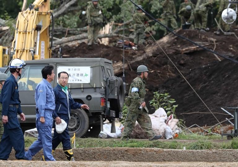 Japan PM visits quake-hit Hokkaido as toll rises to 42