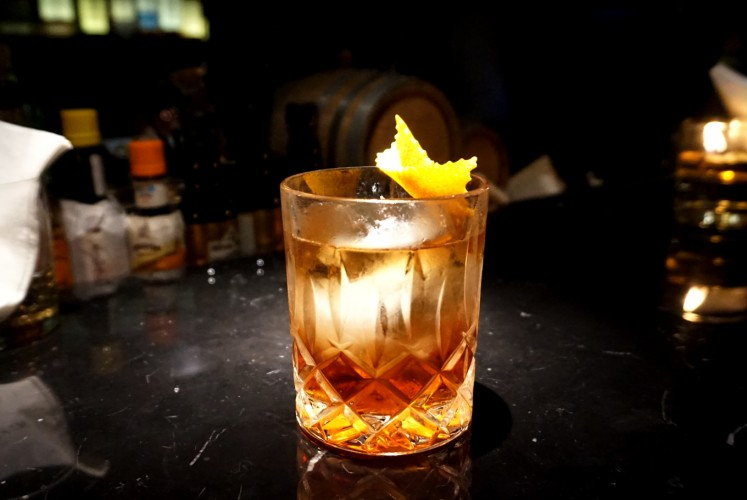 Goldstein's smoky autumn leaves, consisting of whiskey, Calvados, sweet Vermouth, Strega and Angostura bitters.
