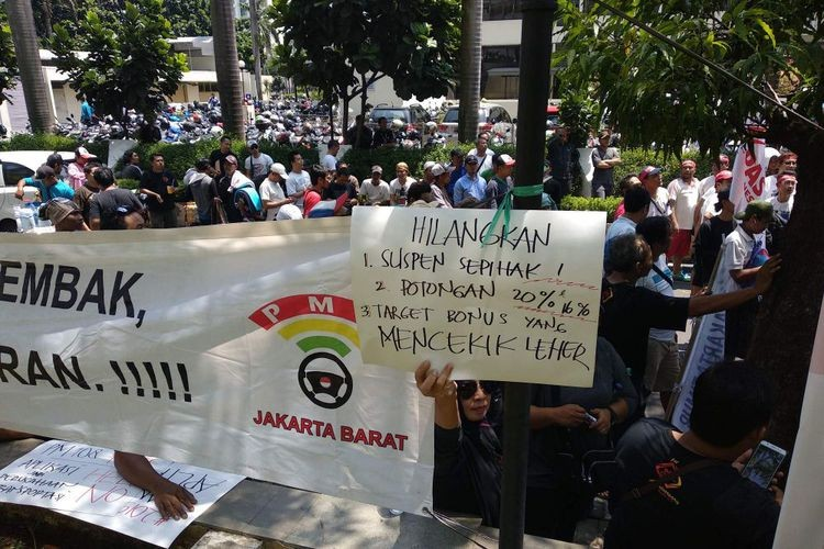 Grab drivers stage rally at Jakarta office