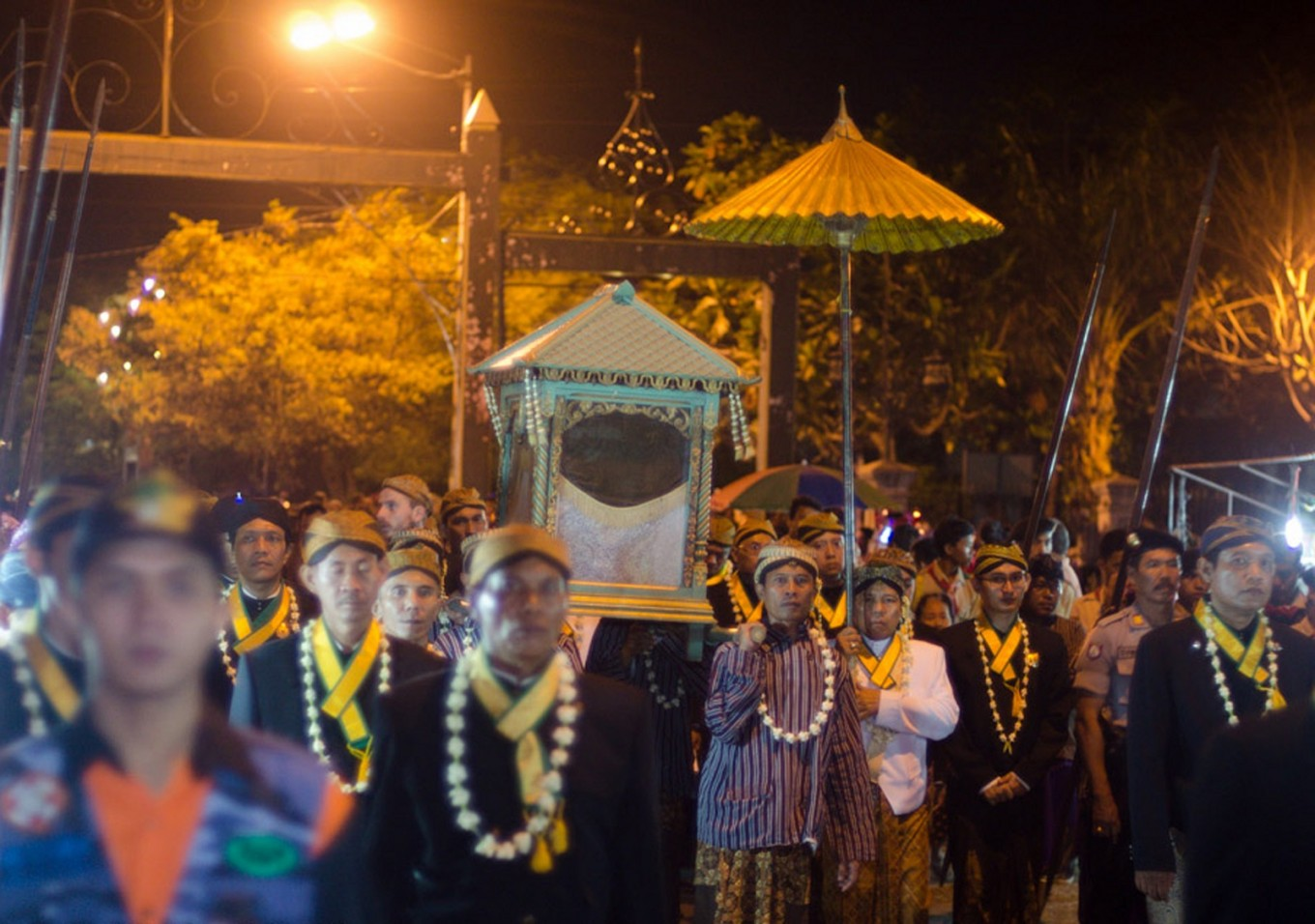 The procession moves along a 3-kilometer route around the walls of Mangkunegara Palace.