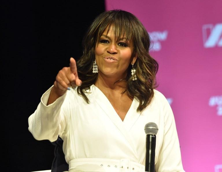 Michelle Obama shelves Paris, Berlin trips for Bush funeral