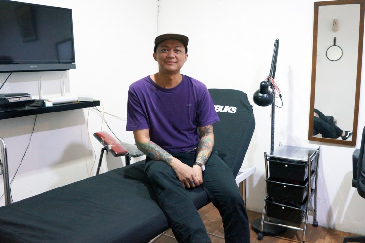 "Tattoo artist Ricky ""Panky"" Stefanus in Bucksbuks Tattoo parlor."