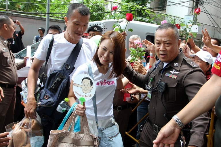 Thai junta charges four with sedition over T-shirts