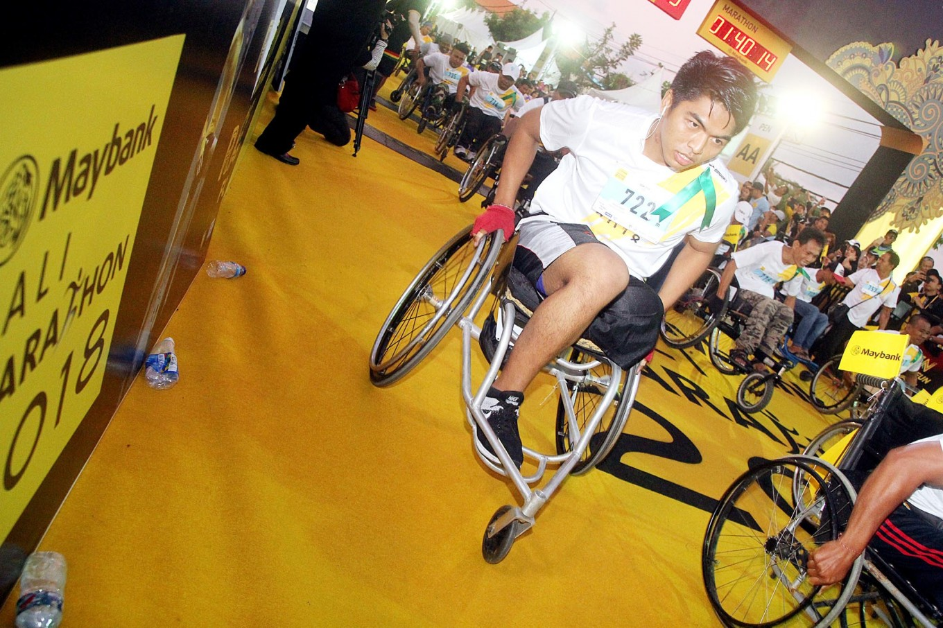 Inclusive race: A man in a wheelchair joins the 2018 Maybank Bali Marathon's wheelchair category on Sept. 9 in Gianyar, Bali. As many as 52 disabled athletes took part in the category.