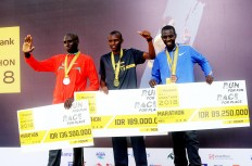 Kenya's fastest gentlemen: Winners of the 2018 Maybank Bali Marathon's men's full marathon category on Sept. 9 in Gianyar, Bali, all of whom come from Kenya, pose together for a photograph. The first-place winner of the event is Cosmas Matolo Muteti (center), followed by runner-up Kiprop Tonui (right) and third-place winner Cossmas Kimutai (left).