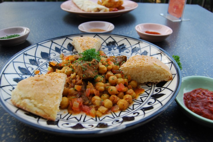 Kerhin bel Hummus (beef with chickpea) is served at Tangier.