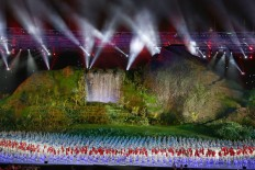 Indonesian athletes walk onto the stage during the opening ceremony of the 2018 Asian Games at Bung Karno Stadium. JP/PJ Leo