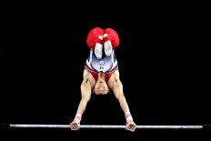 Chinese Taipei's Tang Chia Hung performs during the artistic gymnastic men's bar competition. JP/Seto Wardhana