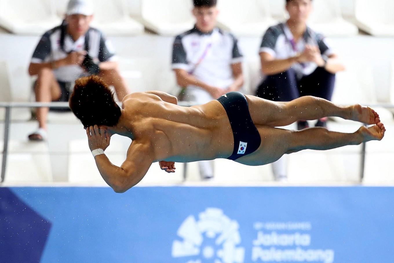 South Korea's Yeongnam Kim competes in the men's diving 3-meter springboard. JP/PJ Leo