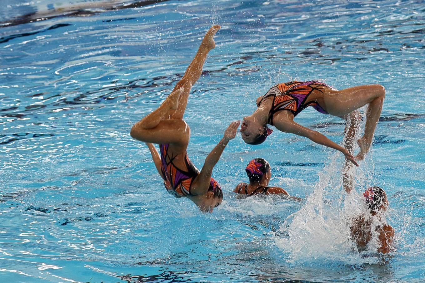 The Singapore team competes in the women's artistic swimming team's technical routine. JP/Seto Wardhana.