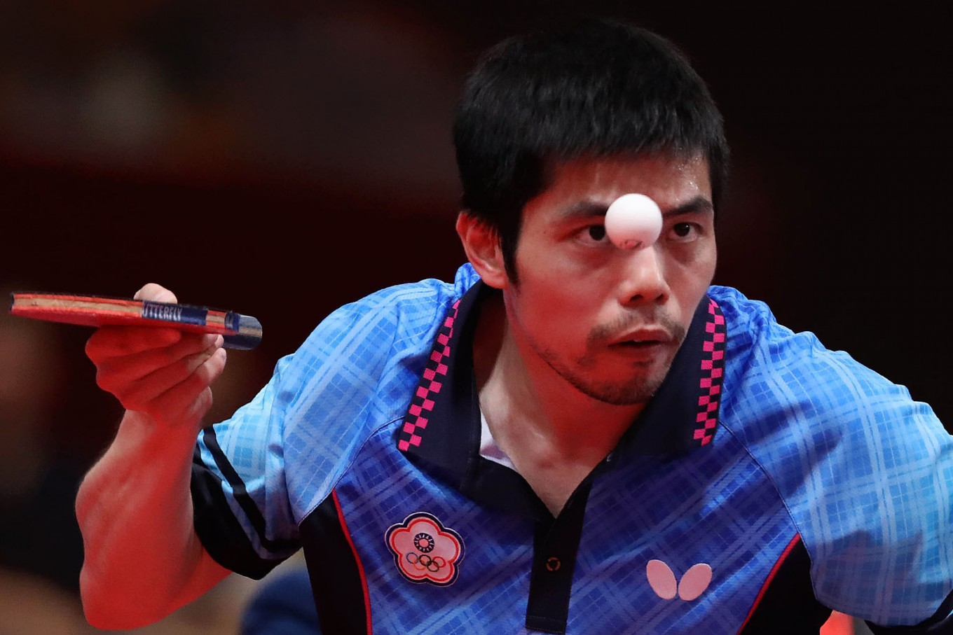Chinese Taipei's Chihyuan Chuang keeps his eye on the ball in a men's table tennis match. JP/PJ Leo