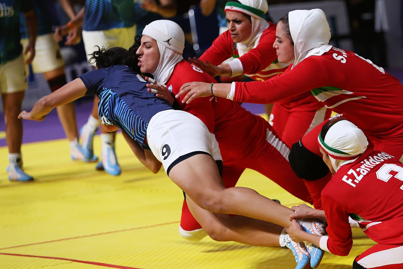 The Iranian women's team tackles an Indian athlete in the women's kabaddi final. The Iranians clinched the gold. JP/PJ Leo