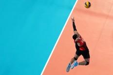 Indonesia's Maulana Aji makes serves during the men's volleyball quarterfinal match against South Korea. JP/Seto Wardhana