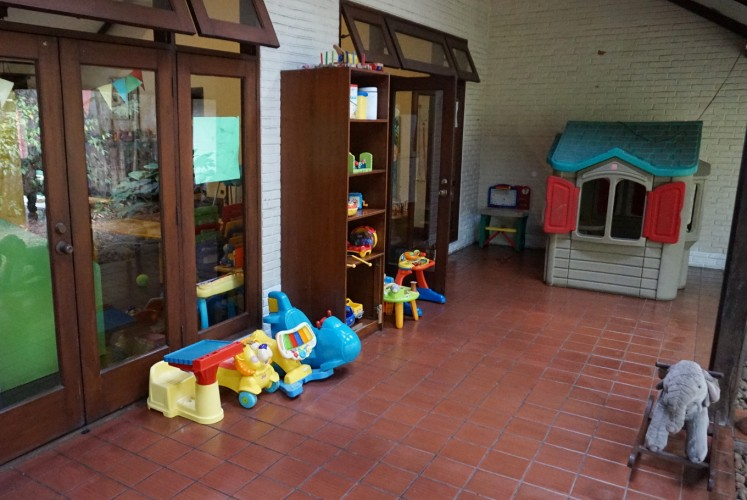 Kupu Kupu Daycare has a semi-outdoor terrace where children can play.