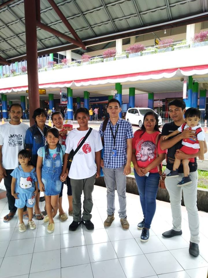 Aldi Novel Aldilang, 19, (fourth from right) with his family in Manado, North Sulawesi, upon returning home on Sept. 9.