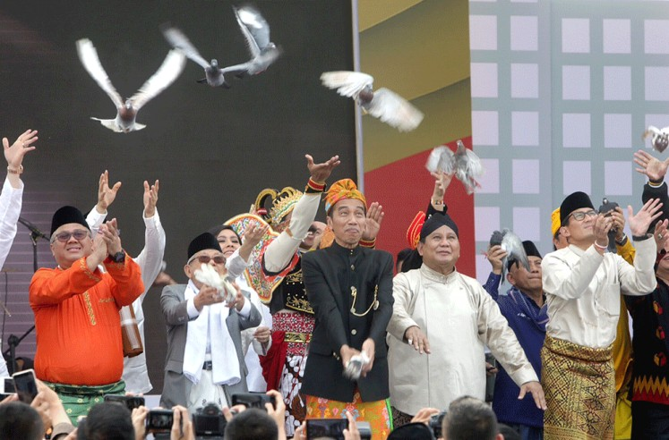 "Give peace a chance: President Joko ""Jokowi"" Widodo (center), who is running for a second term, and his running mate Ma'ruf Amin (second left), along with presidential candidate Prabowo Subianto (second right) and his running mate Sandiaga Uno (right), release pigeons during a peace declaration for the 2019 election campaign at the National Monument in Jakarta. With the declaration, the campaign